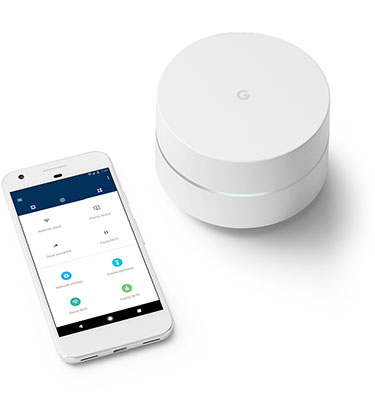Google Wifi beside a phone