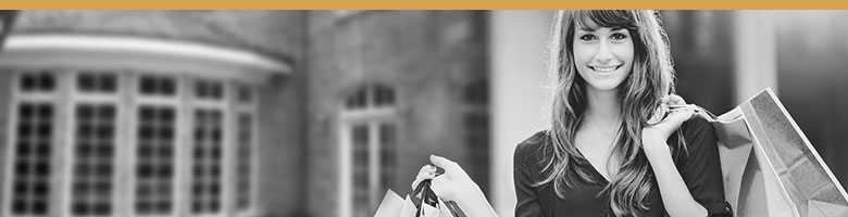 Black and white image of a brand stakeholder, a customer. Woman with shopping bags.