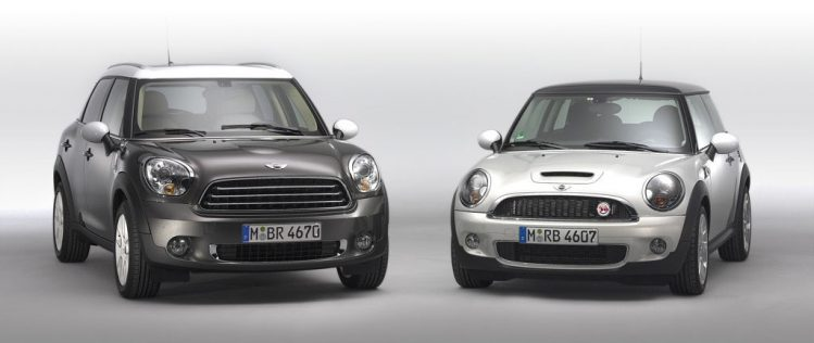 Dark grey Mini Cooper Countryman beside Mini Cooper