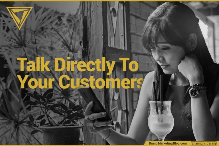 Talk directly to your customers. A woman checking her phone in a cafe in a tropical country.
