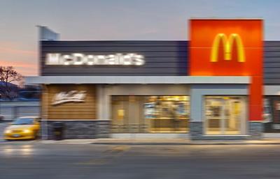 McDonalds restaurant driving past in a car.