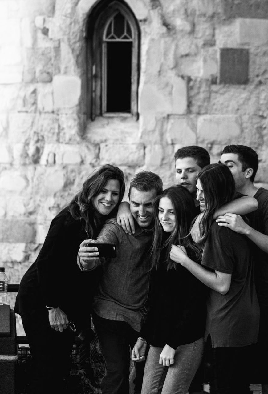 Group of friends taking a selfie in front of a castle parapet