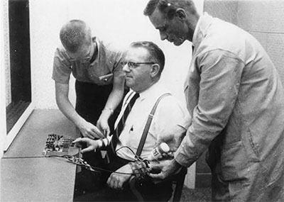An actor being wired into the Stanley Milgram experiment