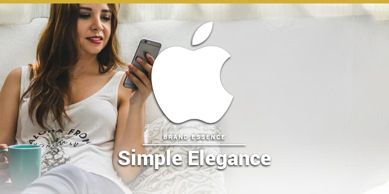 Apple's brand essence is simple elegance. Woman using an iPhone on the couch.