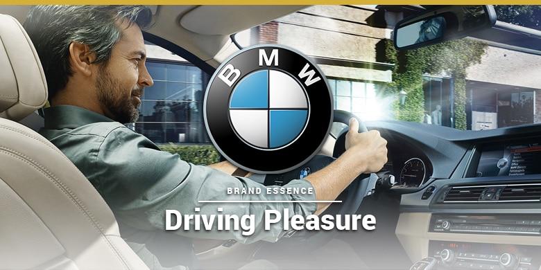 BMWs brand essence is driving pleasure. Man Driving BMW.