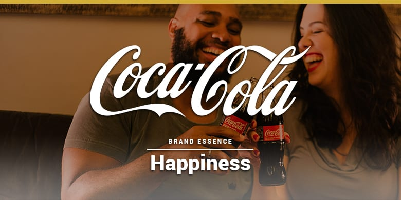 Coca-cola's brand essence is happiness. Man and woman enjoying a coke.