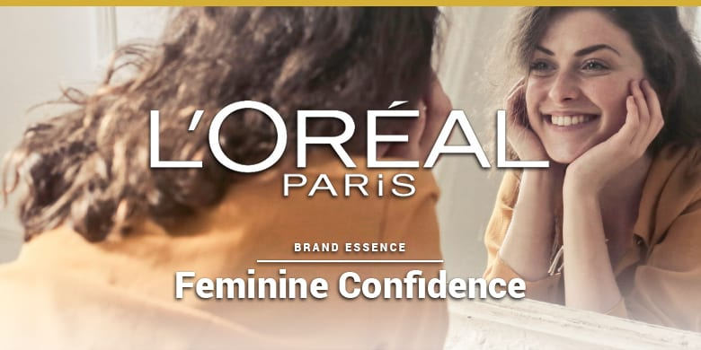 L'Oreal Paris' brand essence is feminine confidence. Beautiful woman looking in the mirror.