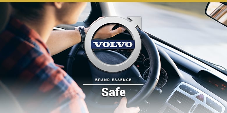 Volvo's brand essence is safe. Woman driving a Volvo.