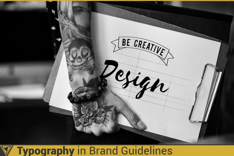 Typography in brand guidelines. A designer with tattoos designing a font by hand.