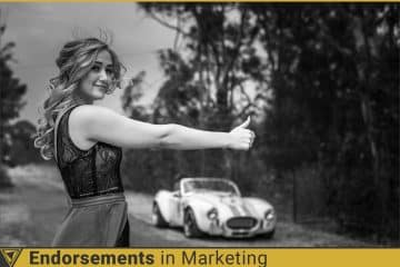 Woman giving the thumbs uo to her classic car. Endorsements in Marketing