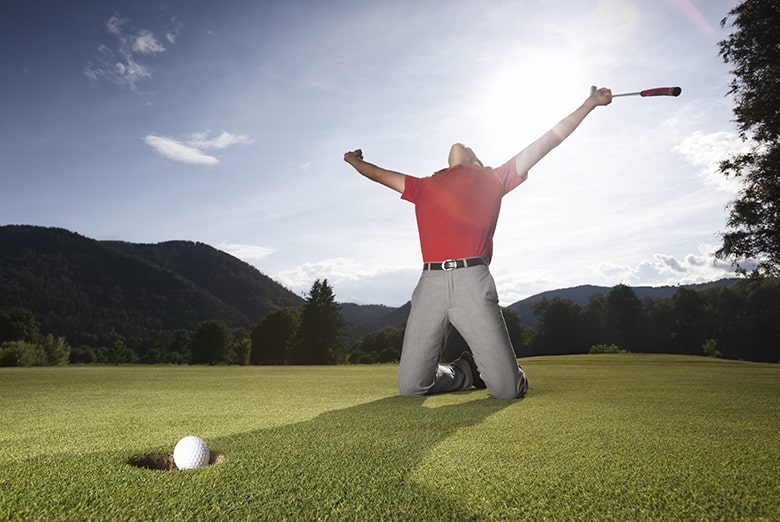Golfer making an eagle putt and celebrating.