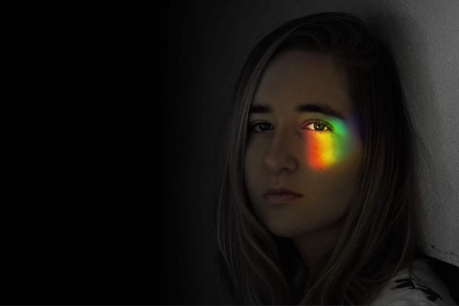 Woman with a rainbow cast over her eye. Best color combinations for logos 2020