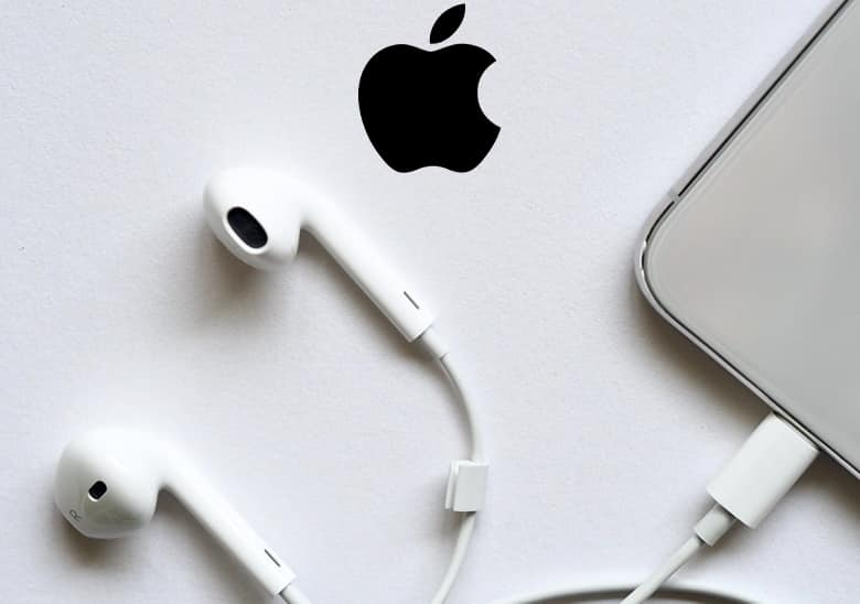 Apple logo and Apple white headphones.