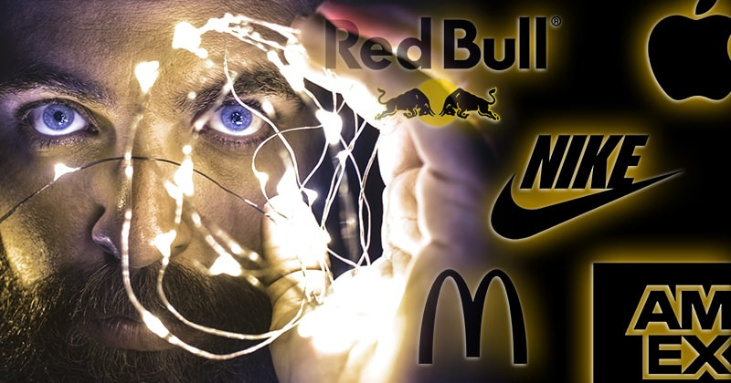 Mentalist performing an illusion. Logos of Red Bull, Nike, McDonald's, American Express, and Apple.